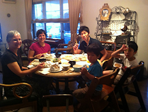 Travelers Enjoying a Home Cooked Japanese Meal and Conservation at Nagomi Visit